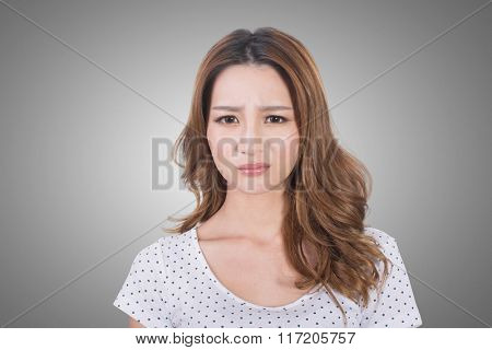 Portrait of a young woman unhappy because of a bad smell.