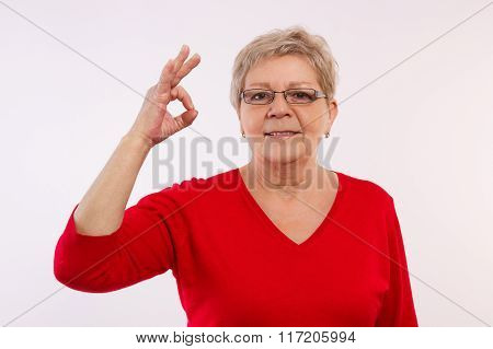 Happy Smiling Elderly Woman Showing Sign Ok, Positive Emotions In Old Age