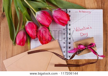 Valentines Day Written In Notebook, Fresh Tulips, Love Letter And Gift, Decoration For Valentines