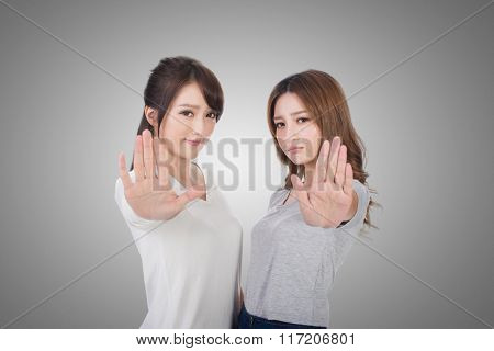Asian women give you a sign of stop.
