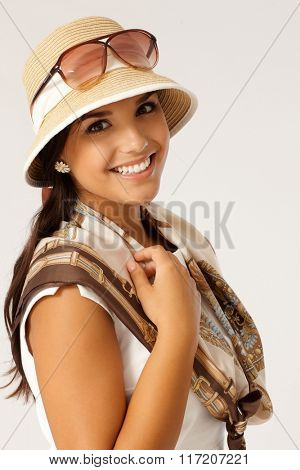 Summer portrait of attractive young woman smiling happy in hat.