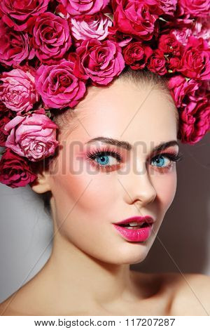 Young beautiful happy woman with fresh make-up in wig of roses
