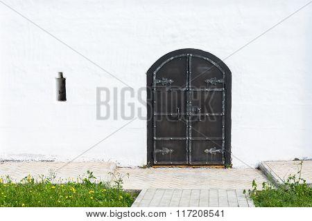 Old Black Metal Door In The Monastery Church.