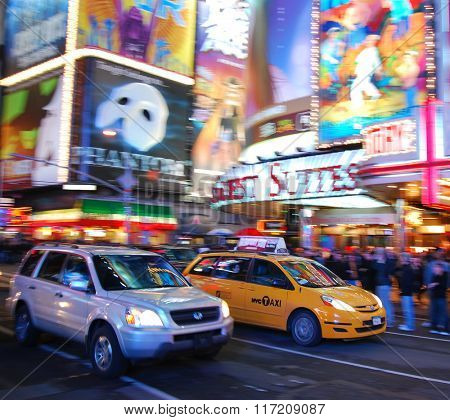 NEW YORK CITY, NY - SEP 5: Times Square with Taxi and Theater on September 5, 2010 in Manhattan, New York City. Times Square is featured with Broadway Theaters and LED signs as a symbol of NYC.