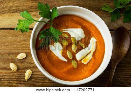 Pumpkin Soup On The Dark Wooden Background