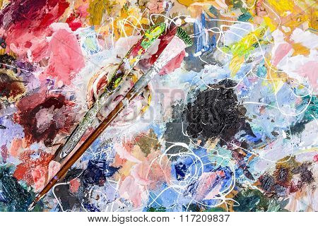 The Palette Of Artist With A Cup For Mixing Oil Paints And A Brush With A Knife