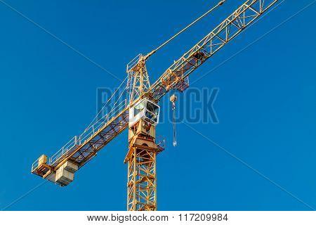 Crane. Blue sky.