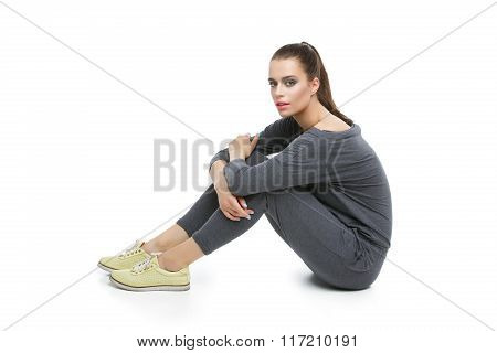 Beautiful girl in grey overalls