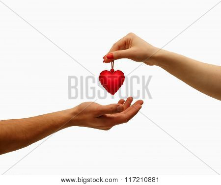 Closeup Girl's Hand Giving Red Heart In Hand Men, Isolated On White