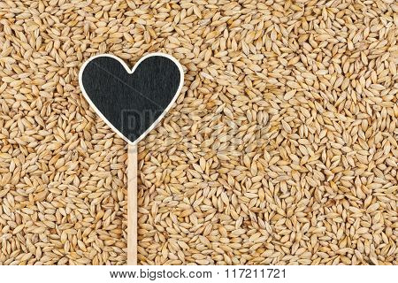 Pointer In The Form Of Heart Lies On Barley Grains