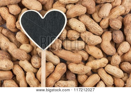 Pointer In The Form Of Heart Lies On Peanut