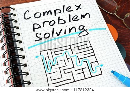 Complex problem solving written on notebook.