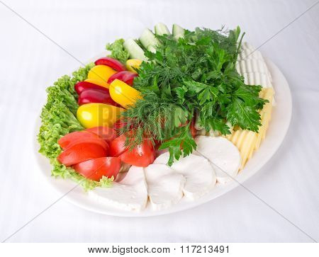 Fresh vegetables and various cheeses.