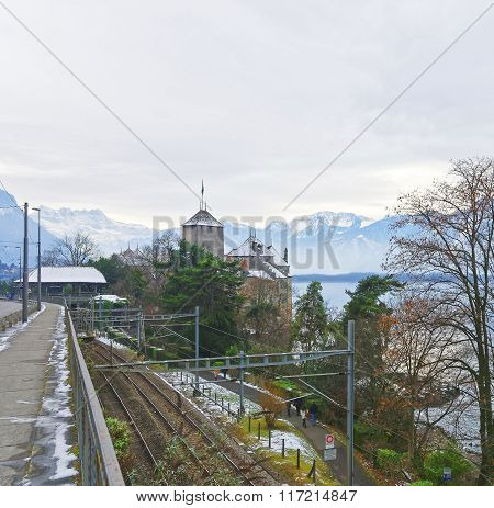 VEYTAUX SWITZERLAND - JANUARY 2 2015: View to the Chillon Castle from a bridge. It is an island castle on Lake Geneva (Lac Leman) in the Vaud between Montreux and Villeneuve.