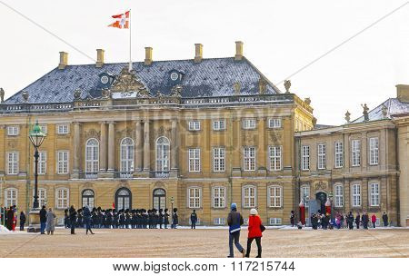 COPENHAGEN, DENMARK - JANUARY 5, 2011: Guard change in Amalienborg in winter. Amalienborg is a Royal Palace in Copenhagen Denmark. It consists of four identical classical palaces around the courtyard.