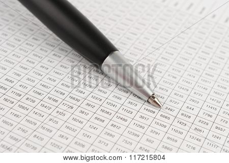 Black Ballpoint Pen Pointing To A Table Cell