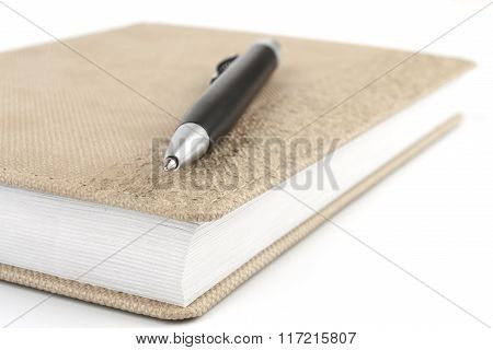 Black Ballpoint Pen On Diary Beige