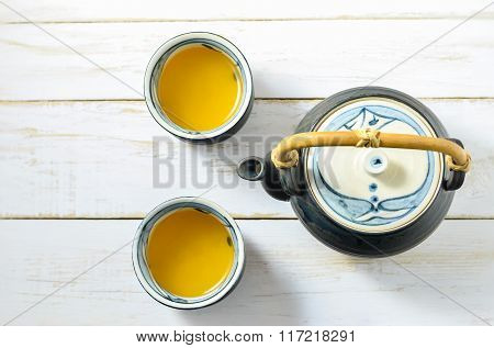 Cup Of Japanese Green Tea With Teapot