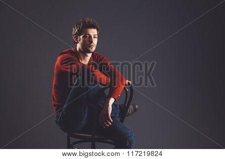 Young melancholic man sitting