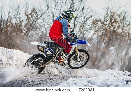 racer on a motorcycle jump on hill
