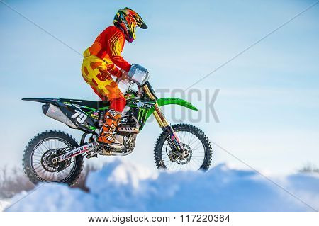 closeup rider on a motorcycle jump on mountain
