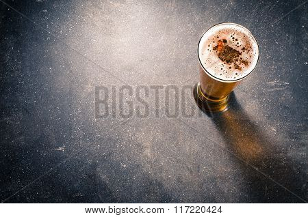 Beer glass on dark table