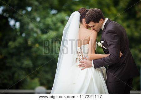 Elegant Bride Kisses The Bride In The Shoulder