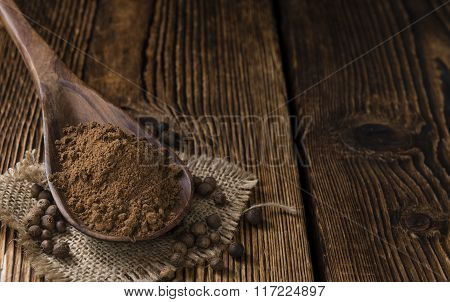 Old Wooden Table With Allspice Powder