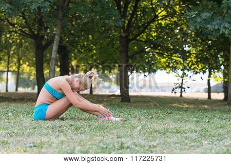 Young Woman  Resting Between Exercises In The Park