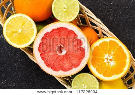 Mix of fresh citrus fruits in wicker backet