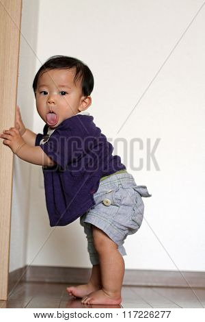 Japanese baby boy pulling up to stand (0 year old)