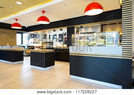 LA VILLE-AUX-DAMES, FRANCE - AUGUST 12, 2015: McDonald's restaurant interior. McDonald's is the world's largest chain of hamburger fast food restaurants, founded in the United States.