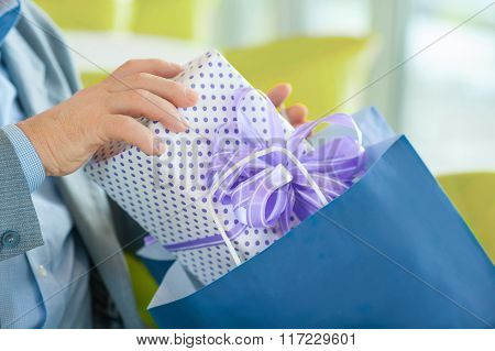 Close-up shot of box with present.