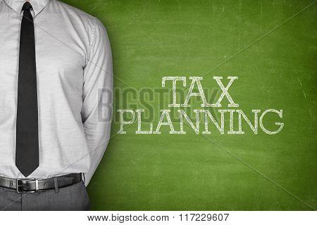 Tax planning text on blackboard
