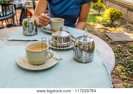Person enjoying tea.