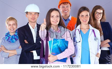 Portrait of smiling people with various occupations and showing ok
