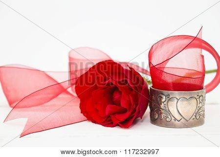 Valentine Red Rose With Organza Ribbon And Antique Silver Serviette Holder On White Background