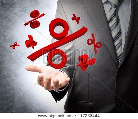 Businessman holding percentage sign