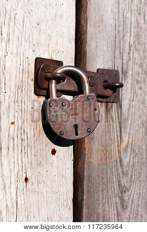 Padlock On The Wooden Door.