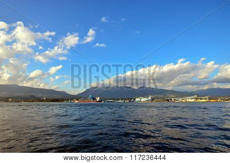 Sea, Mountain And Cloudy Sky From Pier View