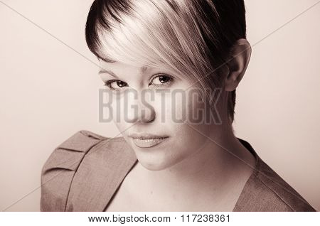 Copper Toned  Shot Of A Confident Young Office Woman . Plain Wall With Copy Space