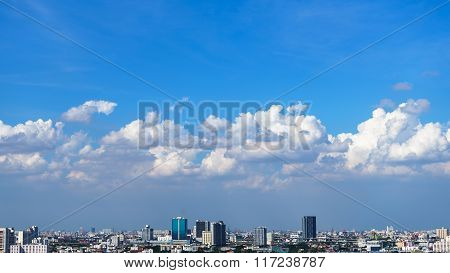 Cityscape With Blue Sky And White Cloud