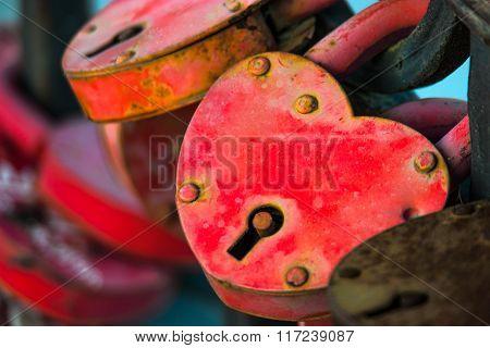 Two love locks. Padlock in the form of heart weathered. Macro