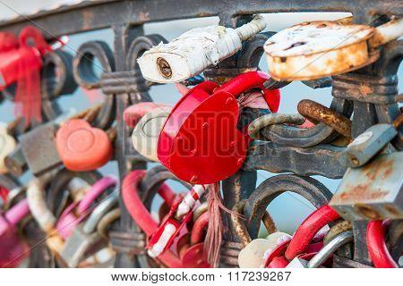 Red Love Locks in heart shape on bridge