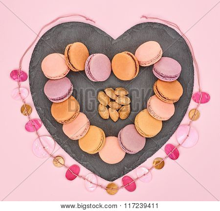 Still life, macarons, heart shape. Love concept