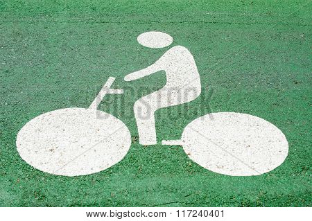 Bicycle sign painted on the street lane