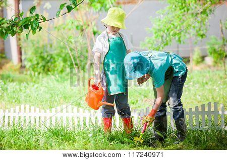 Children Gardening And Watering