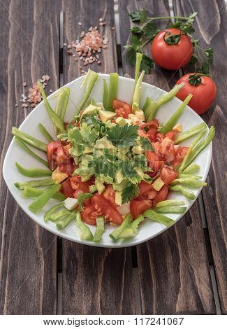 Fresh Salad With Avocado,tomatoes,lgreen Paper And Spices