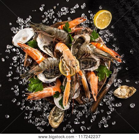 Fresh seafood on black stone, close-up.