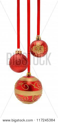 Three Beautiful Red Christmas Balls Hanging On White  Background